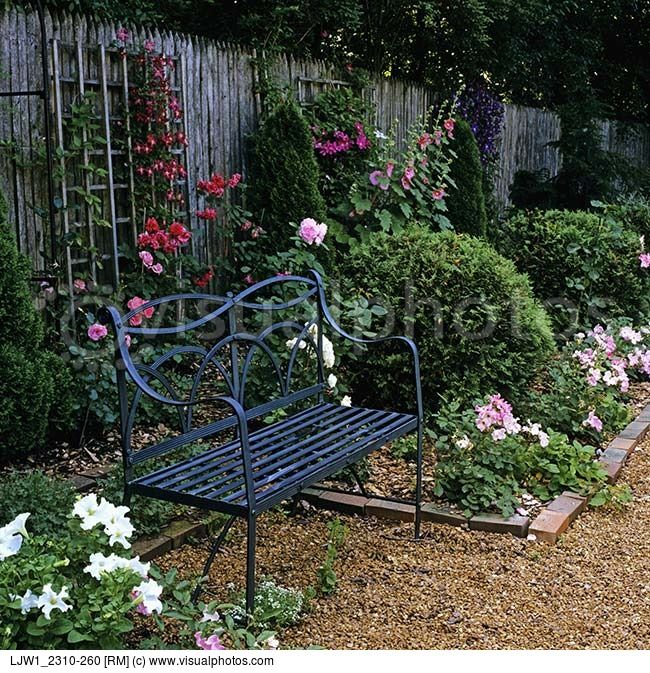 Gardens black wrought iron bench privacy fence with trellis for climbing roses and clematis - Climbing rose trellis ...