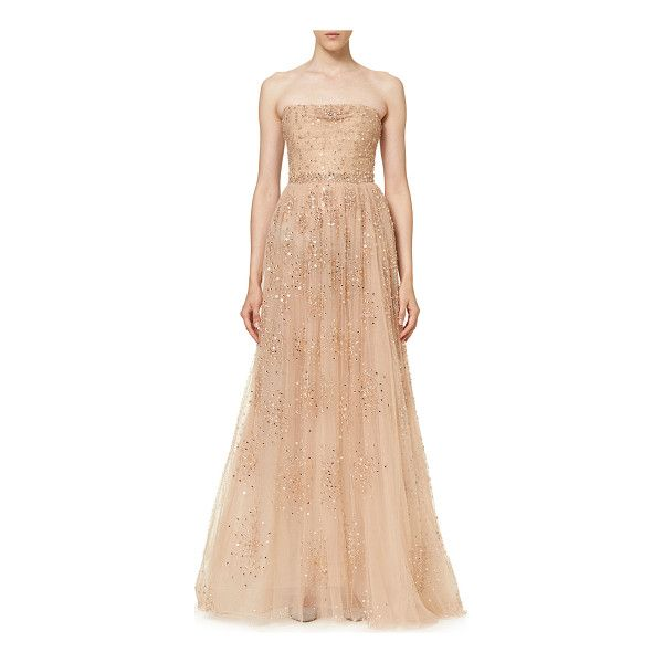 Carolina Herrera star-embellished tulle gown. Straight, strapless lining. Fitted bodice. A-line skirt. Train at back. Hidden back zip. Nylon