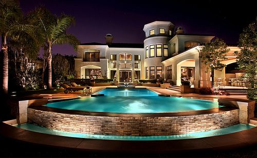 absolutely splendid mediterranean inspired luxury mansion exterior design and swimming pool