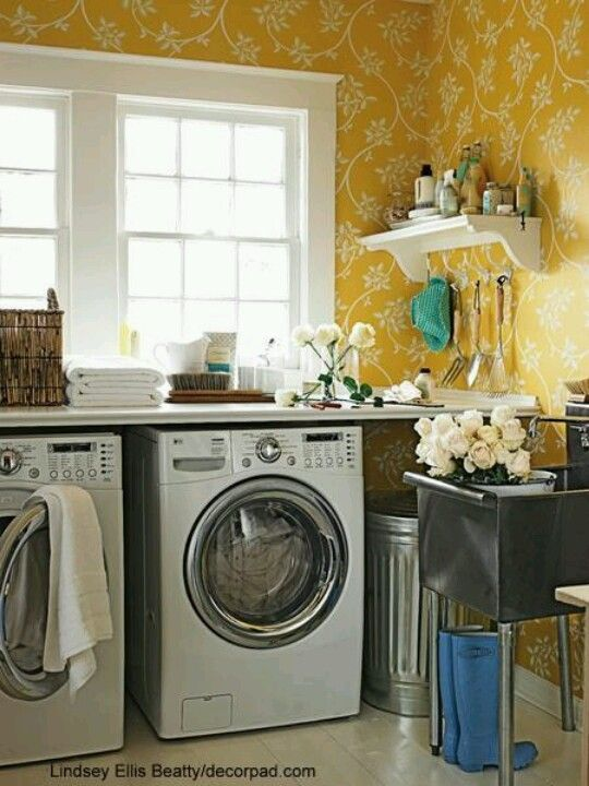 Lindsey ellis beatty sunny yellow laundry room with white washer dryer bright yellow farrow ball the ringwold papers wallpaper and stainless steel