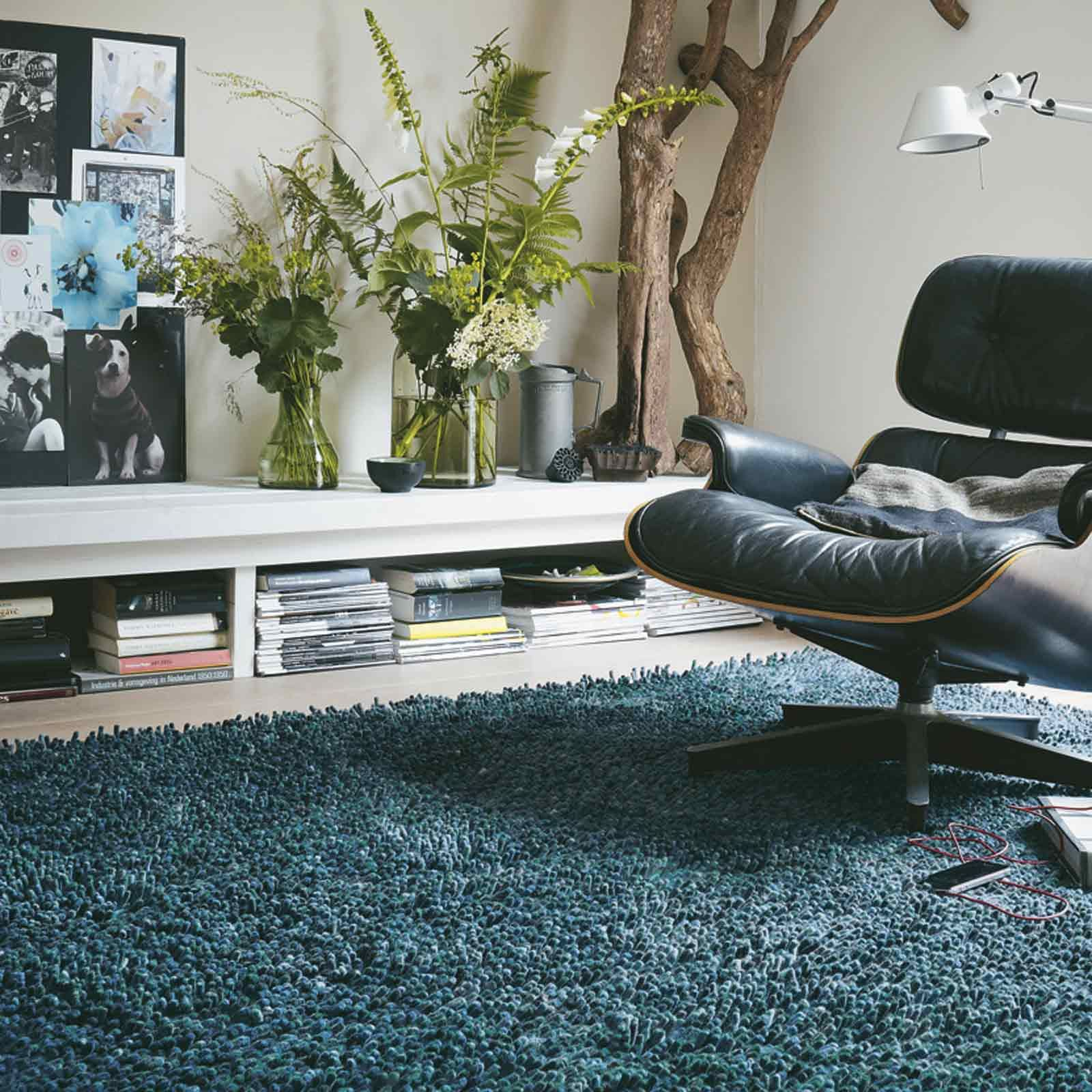 Steel rugs are made in the Netherlands on axminster looms and feature a felted, 100% pure wool pile. The thick blue and green yarns have been developed using innovative processes to offer superior durability and reduced shedding of the wool fibres. #ShaggyRugs #ModernRugs #InteriorDesign