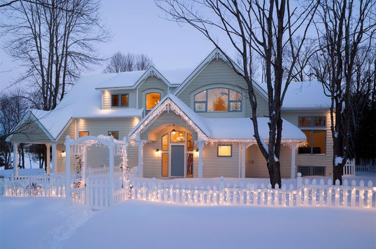 White Christmas lights outdoors snow white house decorate display
