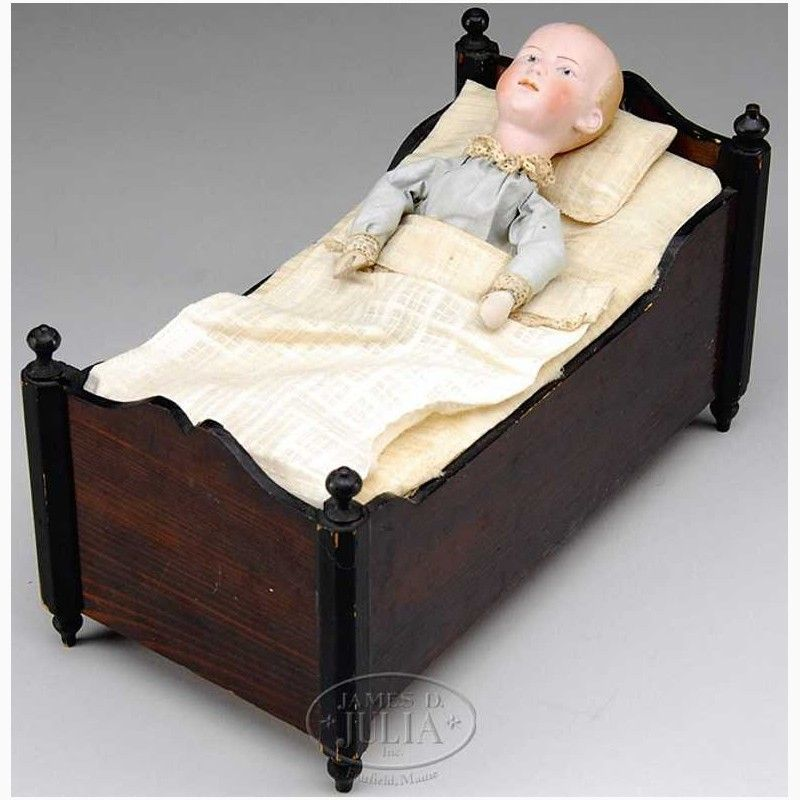 Mechanical boy doll in bed, rare musical/mechanical crank toy of boy in bed with marked Gebruder Heubach head. When crank behind bed is wound music plays and the boy abruptly sits up from his pillow.