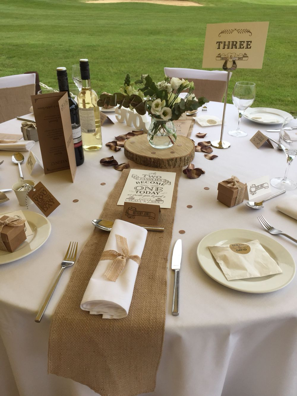 Rustic Romance Table Decor By Fuschia Flowers Ruby And Grace Hessian Runners Log Slices With Natural Napkin Ribbon Creates A Country Style Wedding