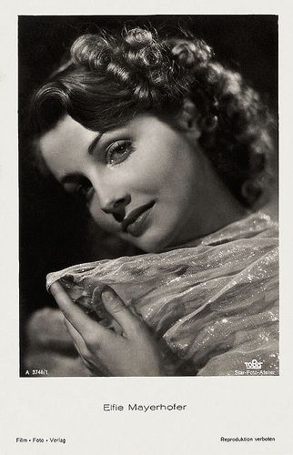 Elfie Mayerhofer  German postcard by Film-Foto-Verlag, no. A 3748/1, 1941-1944. Photo: Star-Foto-Atelier / Tobis.   Attractive Austrian actress and singer Elfie Maierhofer (1917 - 1992) was nicknamed 'the Viennese Nightingale' by the press and the public. During her long career, she starred in nineteen European entertainment films, most of them with Viennese settings.