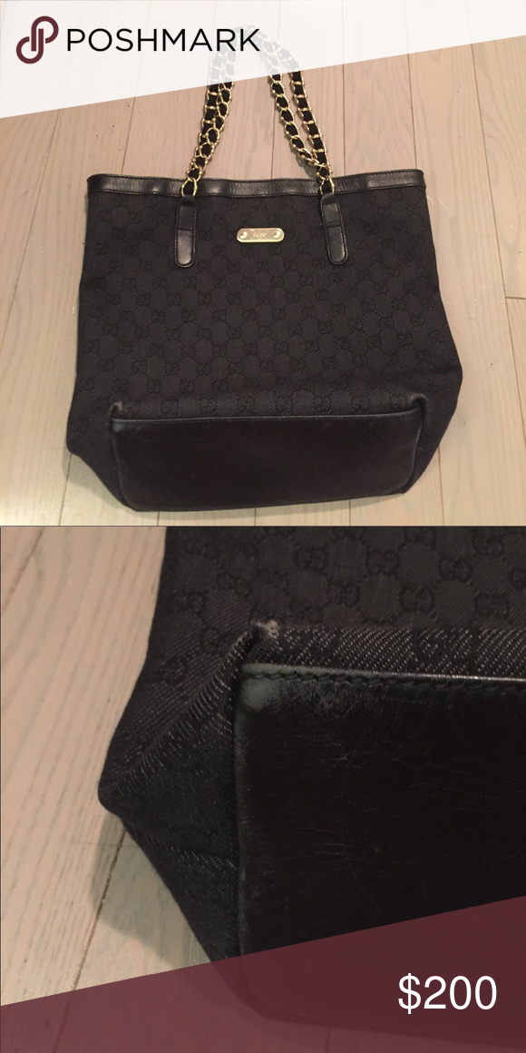 ee1528b7b6 Gucci Black Canvas tote Good condition. Only wear and tear is on the bottom  of the bag. Black canvas with leather trim and gold chain straps. Gucci Bags  ...
