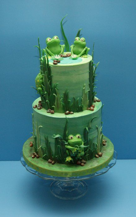 "Frog Cake - ""It is vanilla cake filled and frosted with vanilla buttercream. All other decorations, including the frogs, are made from modeling chocolate."""