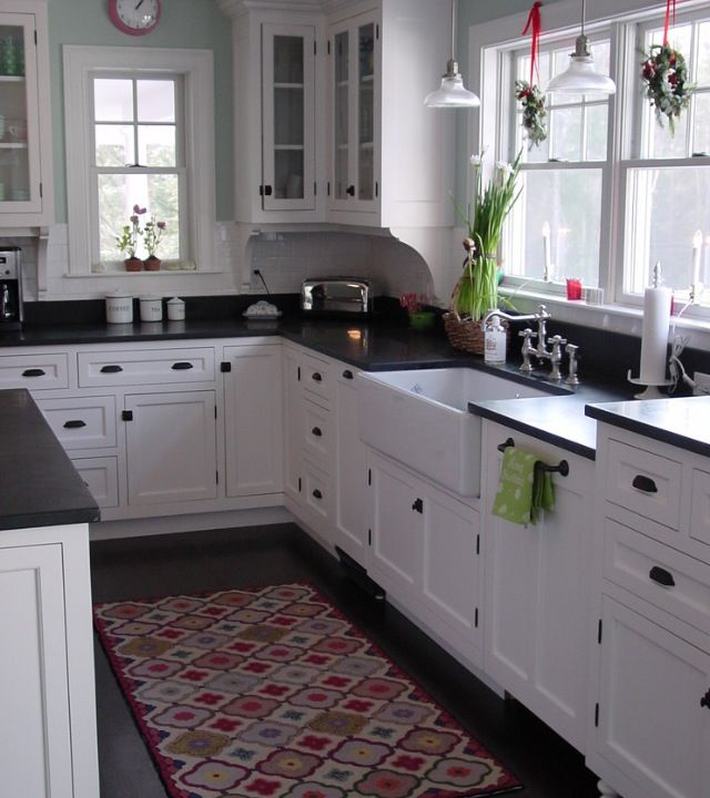 Cozy Country Kitchen In White With Black Countertops Traditional