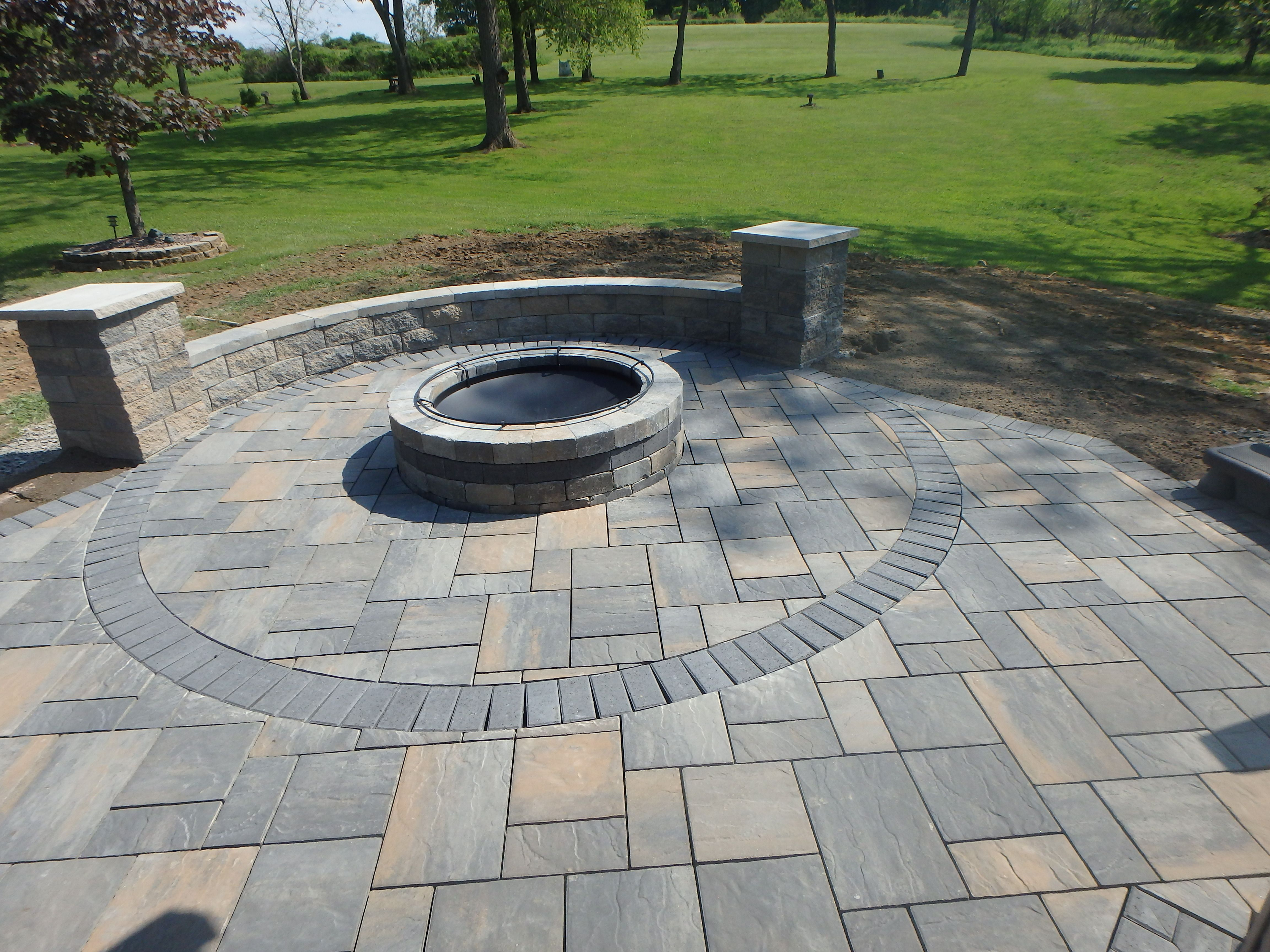 Paver Patio With Charcoal Circle Inlay And Matching Charcoal Accent Strip In Fire Pit Patio Stones Fire Pit Backyard Outdoor Porch