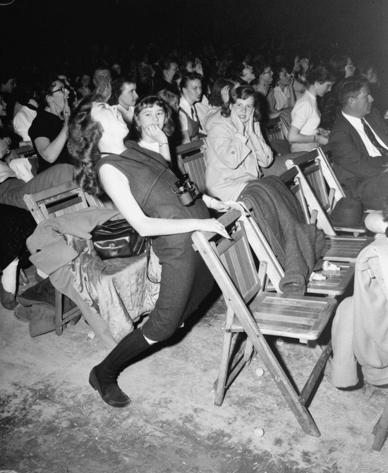 """historicaltimes: """" A teenager at an Elvis Presley concert at the Philadelphia Arena on April 6, 1957 - Read More """""""