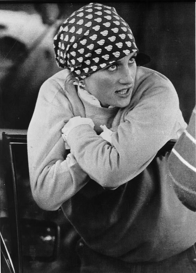 The Sun: Arthur Edwards Royal photos-The royal trendsetter at work While most girls watched polo in a summer dress and pearls back in June 1986, Diana kept things casual with a sweatshirt, bandana and out-of-shot Converse trainers. The picture was taken at Cirencester Polo Club as Di perched on the door of her car chatting to friends.