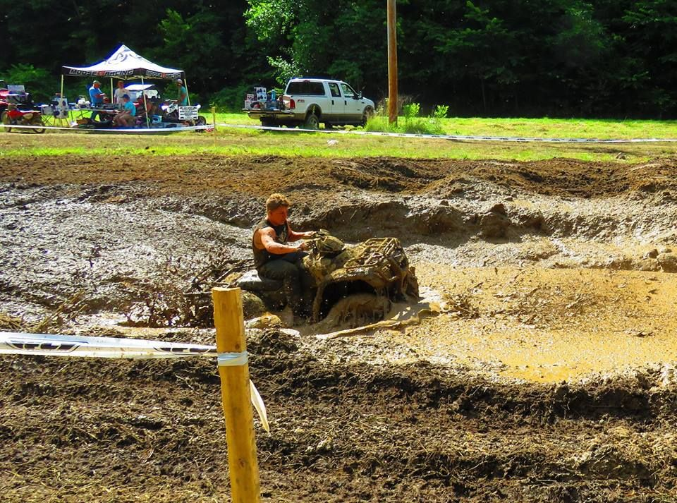 busting the mud with an ATV