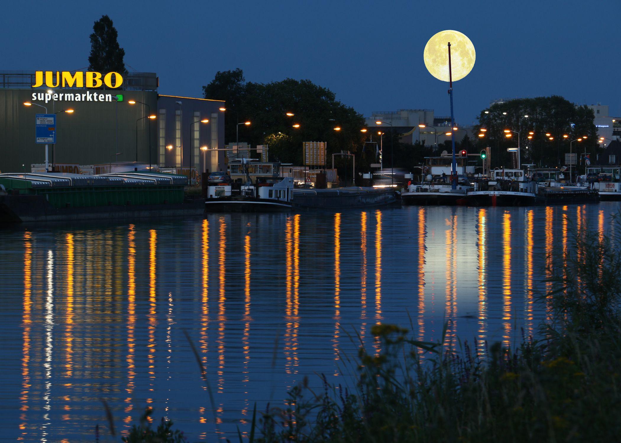 Jumbo supermarket company in Veghel and a beautiful moonrise.