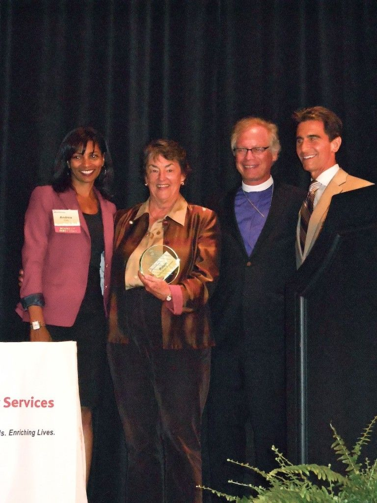 robin azevedo mcroskey of mcroskey mattress co accepts award from
