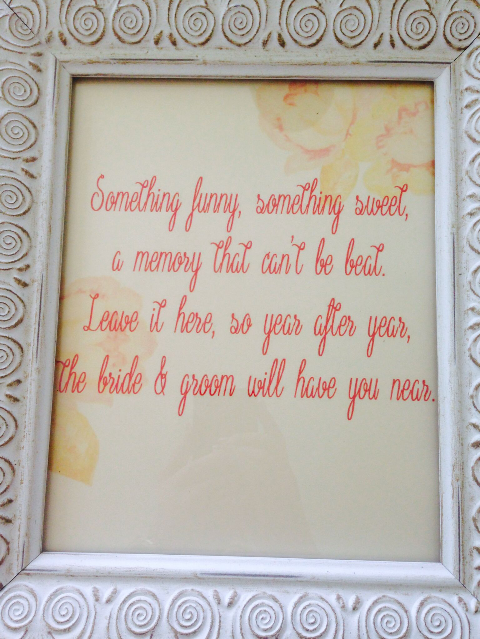 Framed picture on the sign in table with a memory book that guests