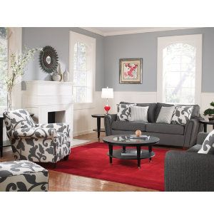 Love the neutral room with the bright rug and patterned accent chairs and pillows