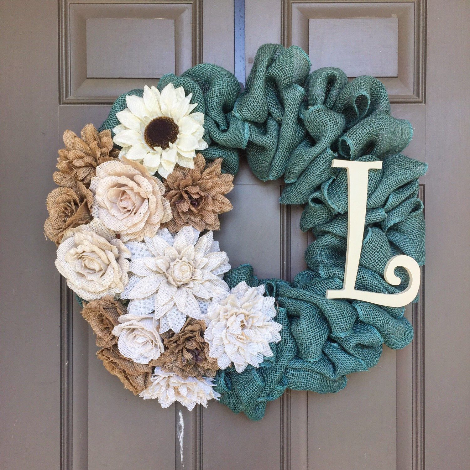 A personalized burlap wreath made with turquoise burlap for Burlap designs