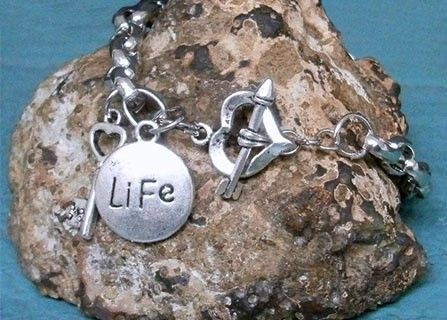 $16 for The Key 2 Life is Love Silver Charm Bracelet including shipping and tax!