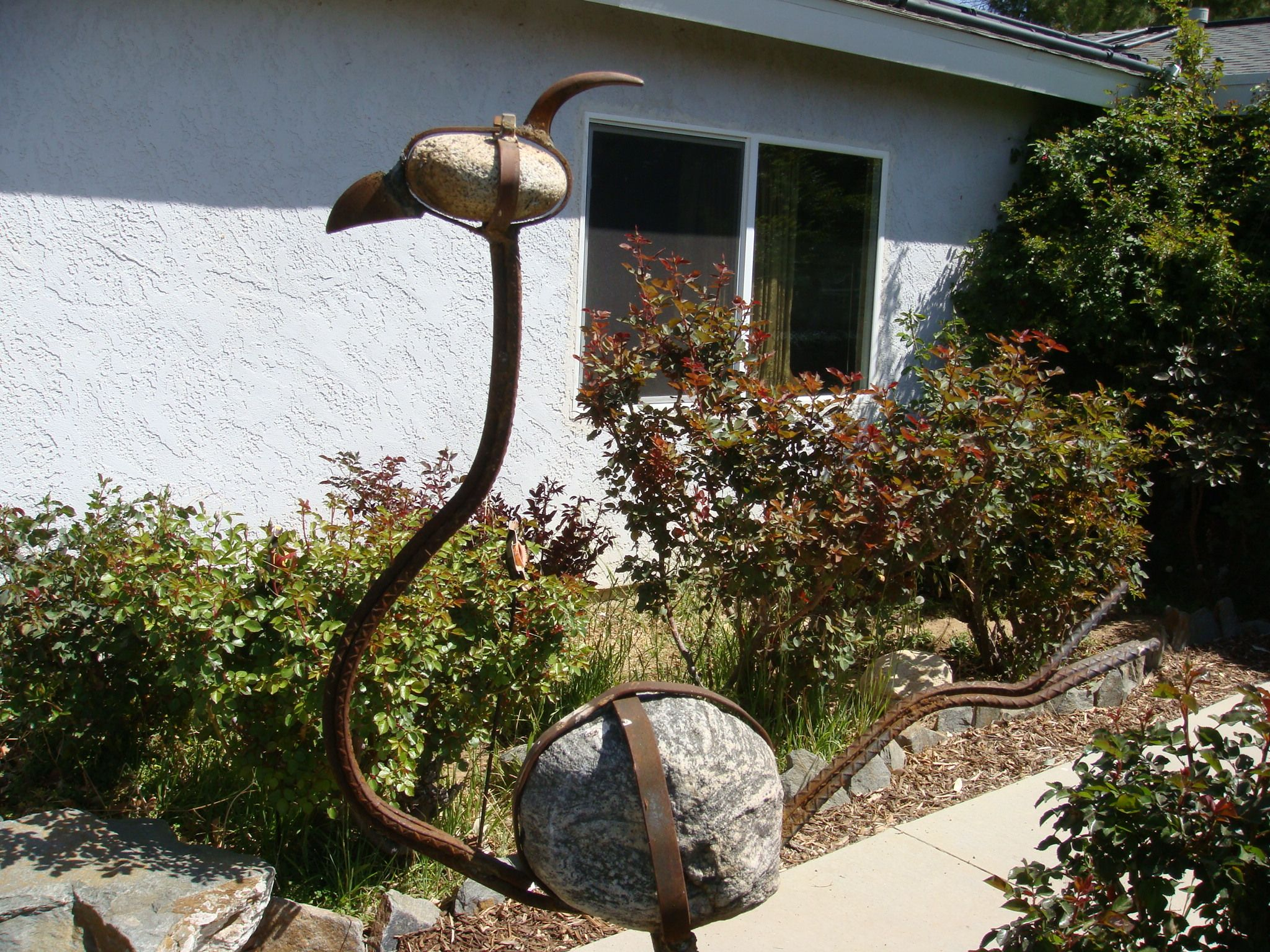 Metal Garden Art with river bed rock and rebar. | Garden | Pinterest ...