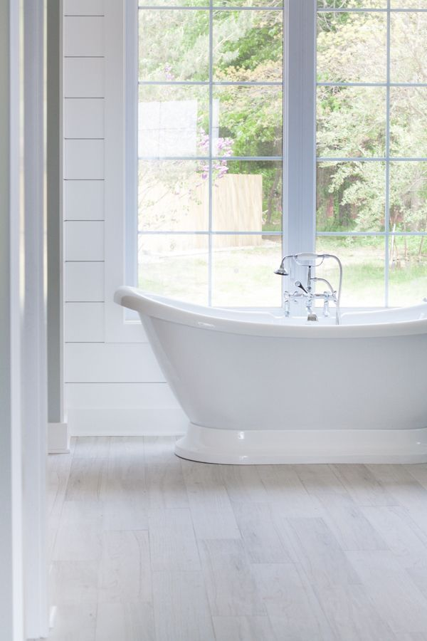 White Washed Faux Wood Tile Gives This Lake House Master Bathroom A Coastal Cottagey Feel With Lots Of Charm And Character