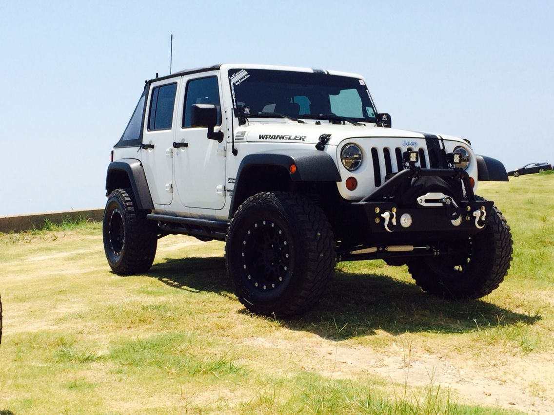 2010 Jeep Wrangler JK Unlimited Sport Lifted 4dr.