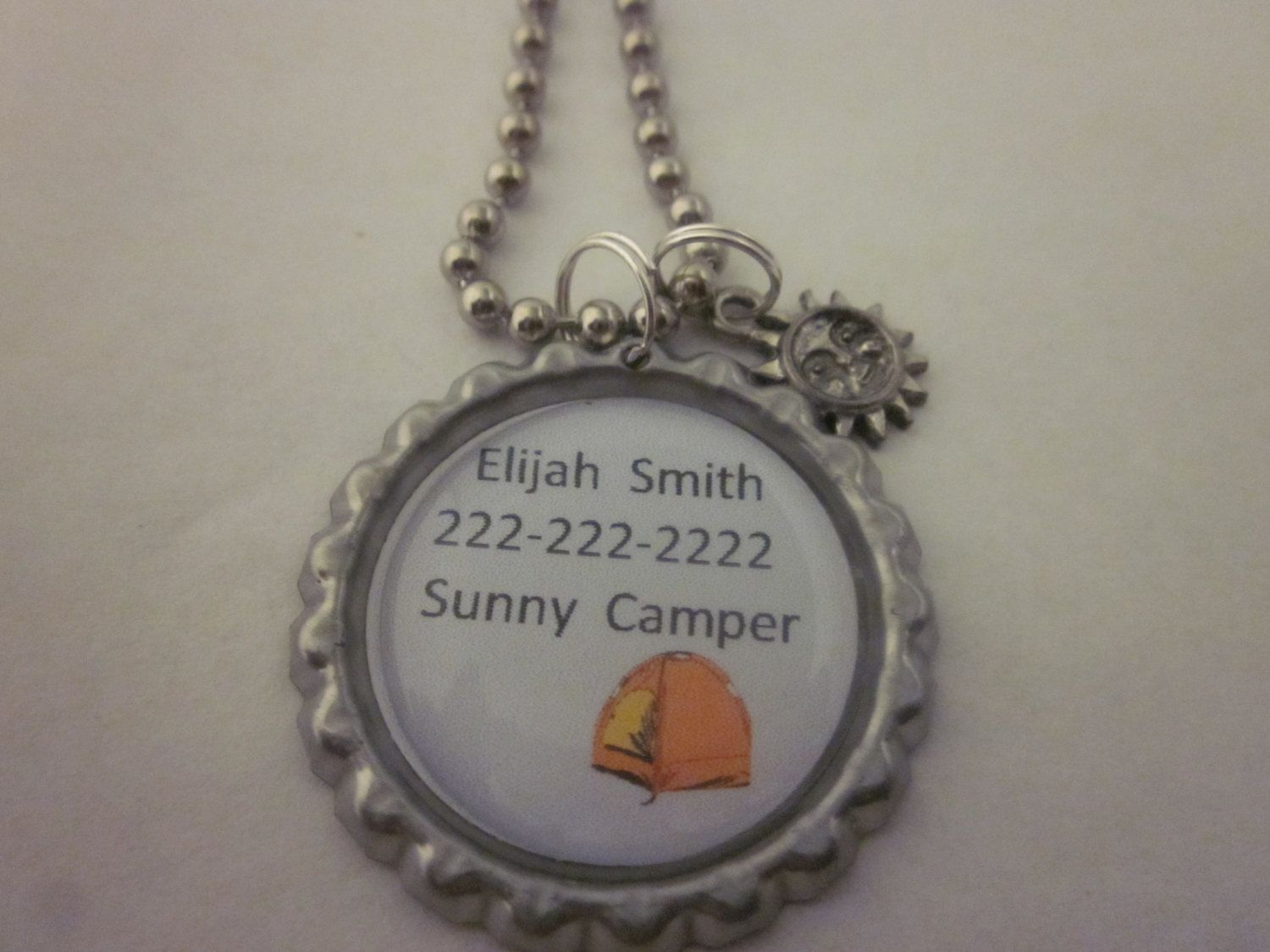Child identification necklace.