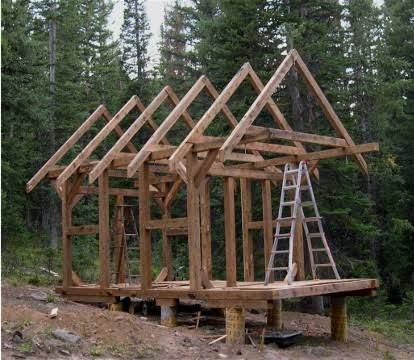 Mark Van Roojen Construction Of A Small 10 X 14 Timber Frame Cabin In The Back Woods Of Wyoming Timber Frame Cabin Timber Frame Plans Small Timber Frame Cabin
