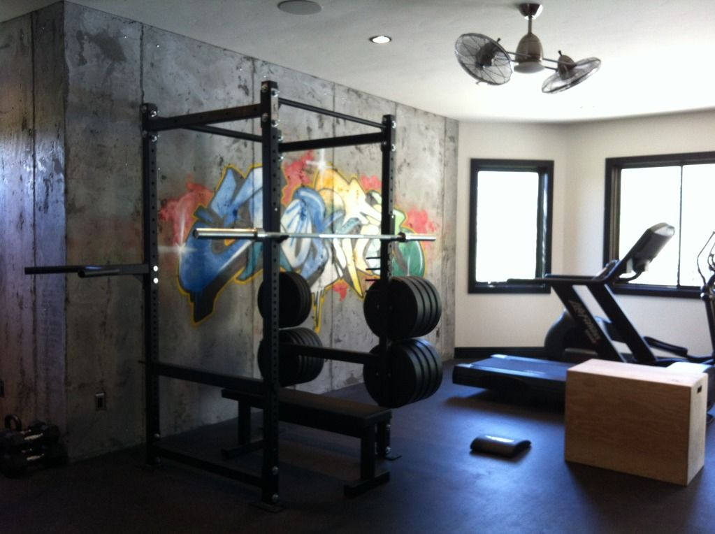 Basement gym w cement walls graffiti art mat floor and