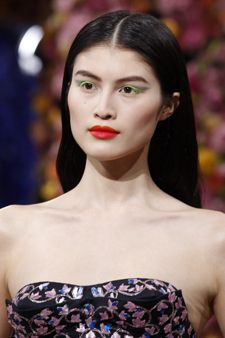 Natural centre-parted style with a soft wave through the lengths at Dior Couture Autumn/Winter 2012