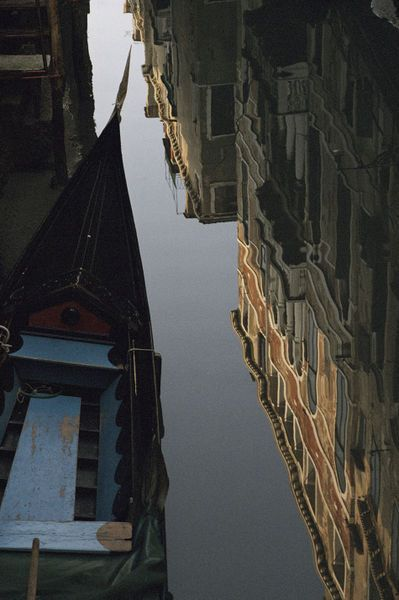 National Geographic: Gondola and building reflections in a canal, Venice, Italy