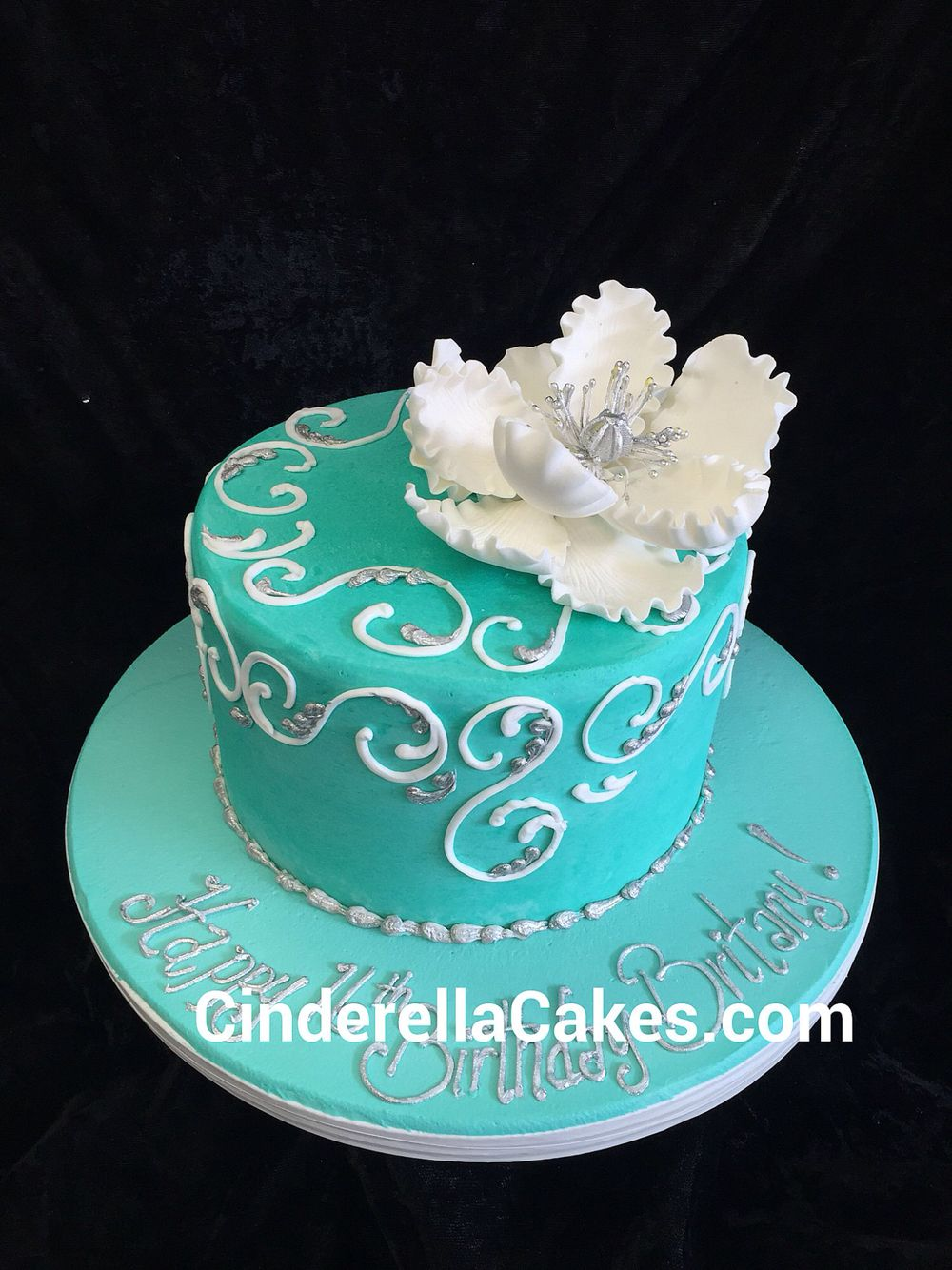 A pretty buttercream birthday cake in the infamous tiffany blue