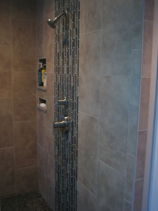 Travertine Tile Shower With Pebble Tile Floor And Glass Tile