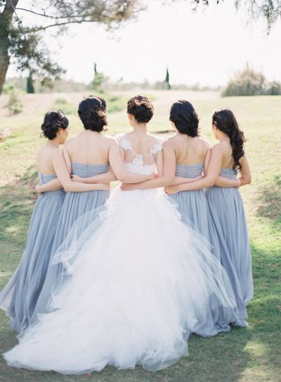 Matching bridesmaid gowns: http://www.stylemepretty.com/2016/03/09/30-must-haves-to-plan-the-ultimate-classic-wedding/