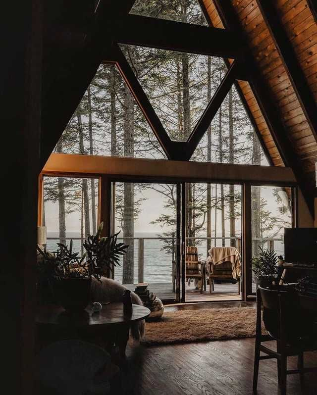 Inside of a warm A-frame cabin on a grey day