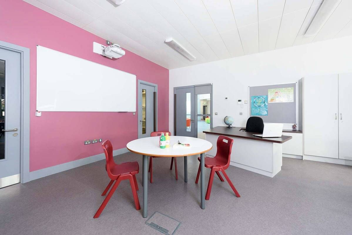 Pink Accent Wall mainstream classroom with pink accent wall and bespoke teachers