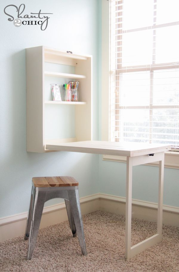 DIY Murphy Desk - when closed DIY folding desk. Has a cute chalkboard on front. Could also use as a vanity, extra cooking space or iron/fold station!