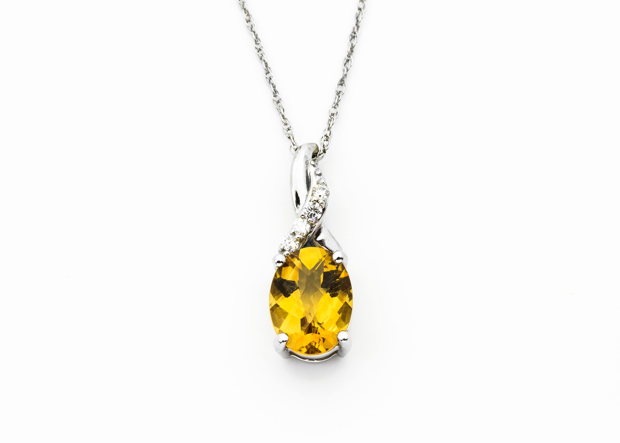 Citrine and Diamonds? A pop of color is a fun way to stand out. This pendant is set in 14K white gold and is new at The Gem Gallery! #montana #bozeman #pendant #citrine #sparkle #jewelry #gold #14K