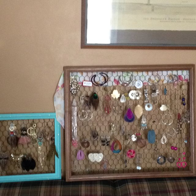 My friend made chicken wire and picture frame things to hang her jewelery!