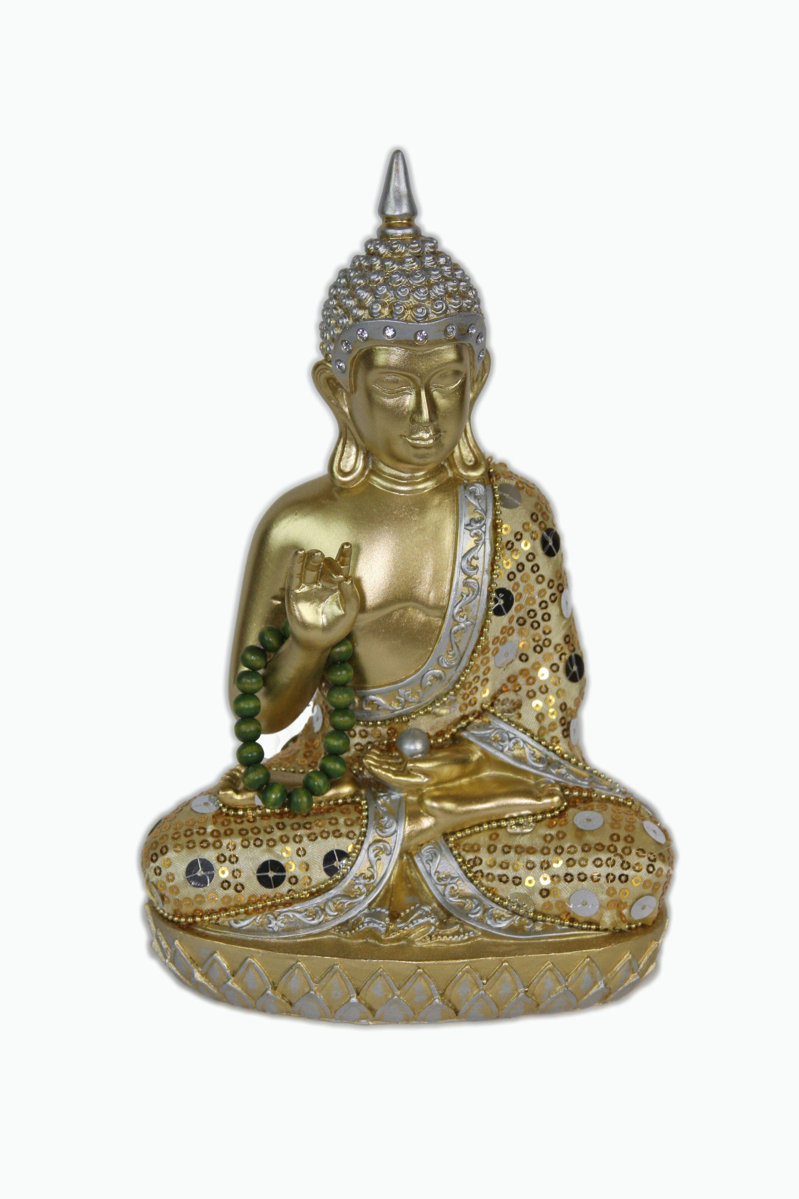 This Buddha statue is displaying the Karana Mudra.