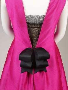 Cristóbal Balenciaga, Detail of cocktail dress of fuchsia silk shantung and black lace with black silk satin ribbons, summer 1966