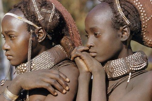 Africa | Coils of beads decorate married Mwila women's hair and necks. Near Humpata, Angola | ©Volkmar K Wentzel