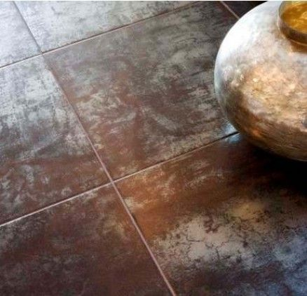 Porcelain tile with a metallic look to it. Very similar to tile I'm