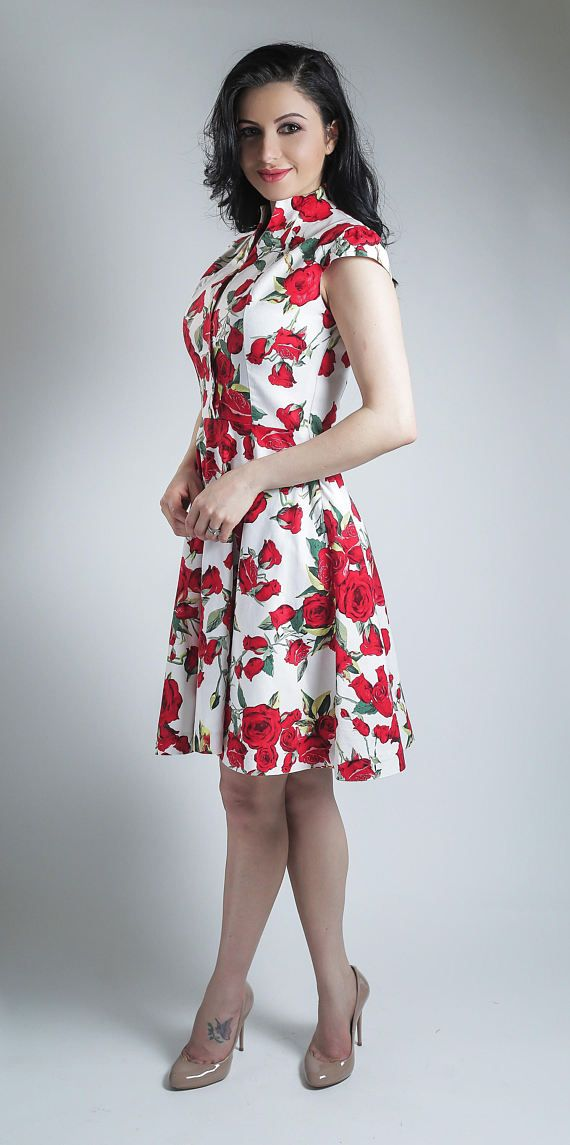 1b93c6178c16 Beautiful floral summer dress with red roses in a white background. This  dress is very elegant with a vintage look, and it is ideal for countless  occasions, ...