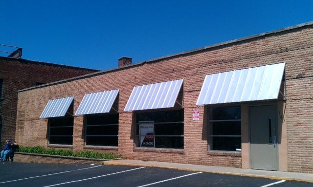 Love The Modern Look Of These Metal Awnings On A Brick Building Metal Awning Brick Building Metal