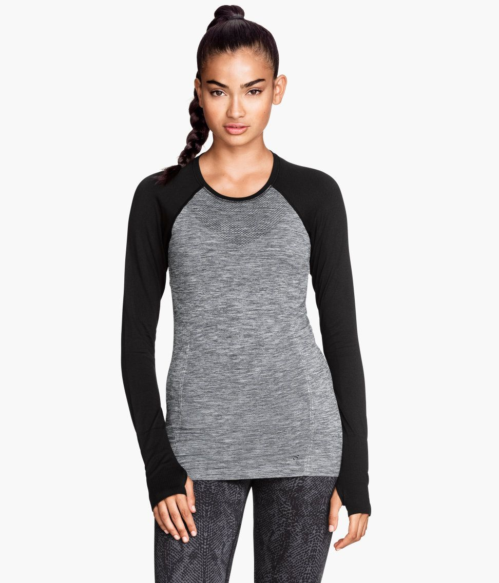 Fitted, long-sleeved sports top in gray & black fast-drying, functional fabric. Seamless, with thumbholes at cuffs.| H&M Sport