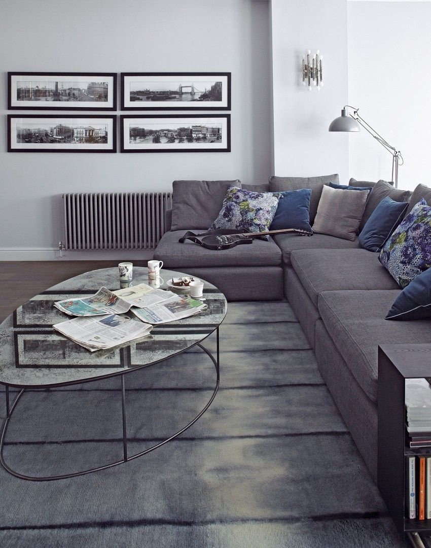 Modern Grey Living Room With L-shaped Sofa And Photographs