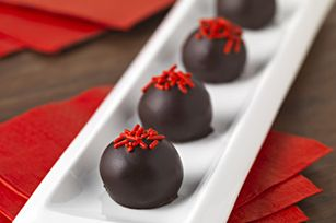 Red Velvet Cookie Balls recipe - Like mini bites of Red Velvet Cake, these rich and delicious treats are made from cream cheese and crushed Golden OREO Cookies and dipped in melted chocolate. #ValentinesDay