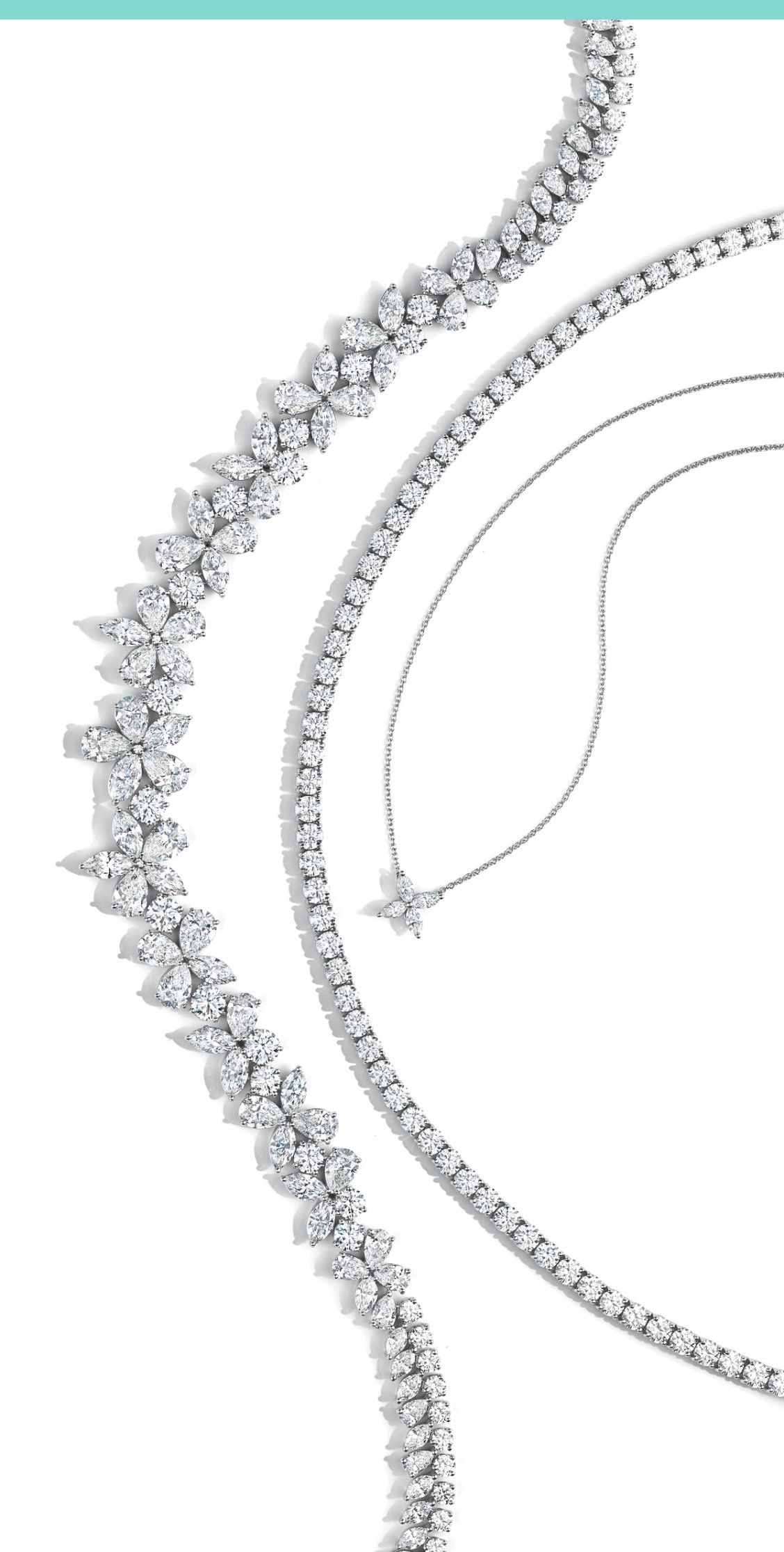 0a5e9a5f2698 Holiday parties require lots of ice. Diamond line necklace and Tiffany  Victoria® mixed cluster diamond necklaces in platinum.