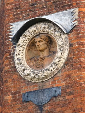 Dotted around the courtyards are terracotta medallions of ...