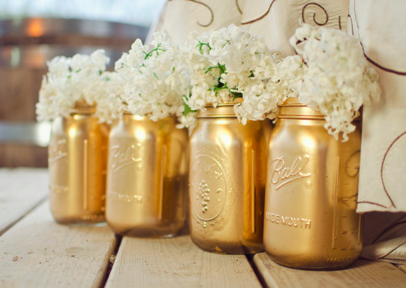 Mason jars painted metallic gold and filled with flowers are a the perfect centerpieces for a rustic wedding ~ http://rusticweddingchic.com/rustic-country-wedding-inspiration